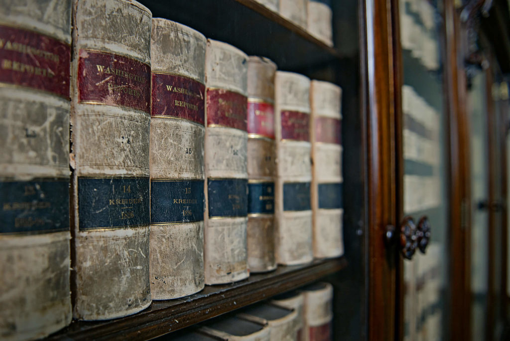 large bookshelf with attorneys books